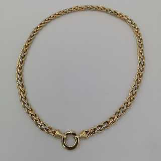 Three-colored cable chain in gold with a large spring ring