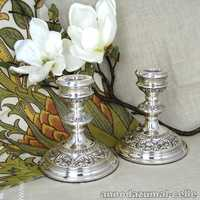 Silver candlesticks with relief decor