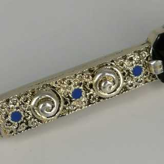 Enamelled Art Nouveau bar brooch with a tourmaline in 835 / - silver