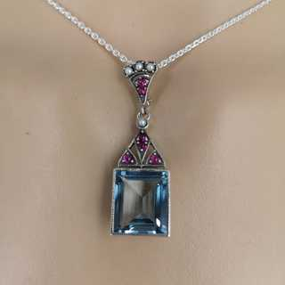 Art Deco pendant in silver with topaz, rubies and pearls