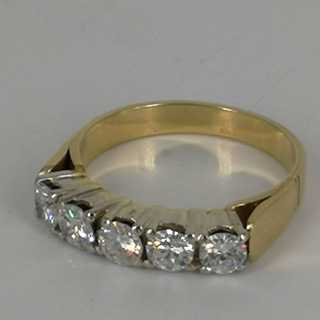 Memory ring in yellow and white gold with five large, sparkling diamonds