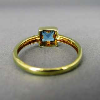 Gold ring with solitaire blue topaz