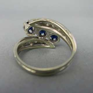 White gold ring with sapphire and diamonds