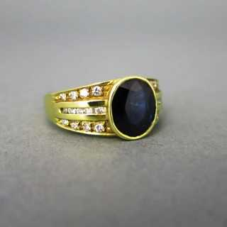 Gold band ring with sapphire and diamonds