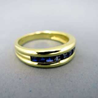 Band ring with cushion cut sapphires
