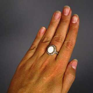 Ring with opal and diamonds in gold and platinum