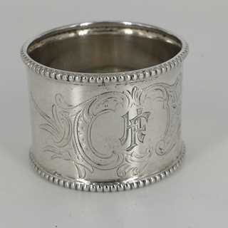 Art Nouveau napkin ring in silver with rocailles decor and monogram