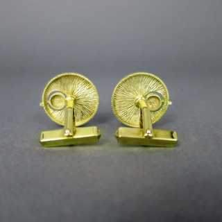 Modernistic gold cufflinks with diamonds