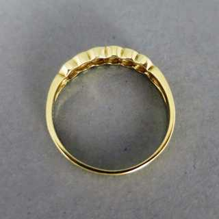 Delicate gold half eternity ring with diamonds